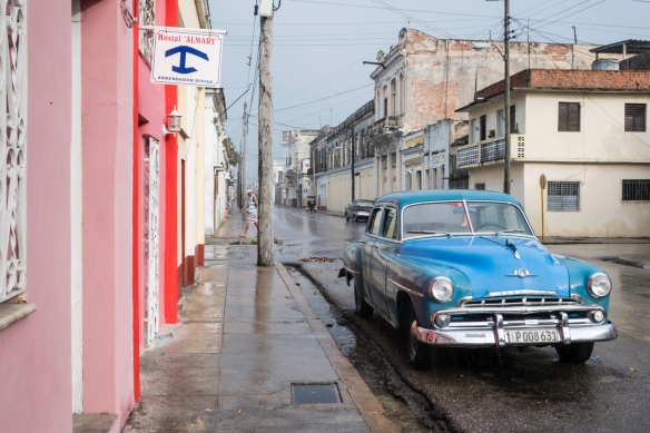 A beautifully restored early 1950s Plymouth in a residential neighborhood near Parque José Martí in the Central Zone of Cienfuegos, Cuba
