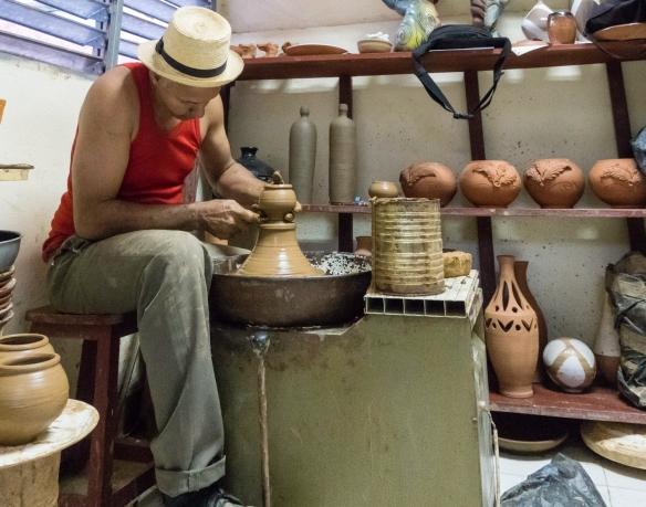 """A ceramist at work at the gallery-workshop """"Casa de la Ceramica"""", Santiago de Cuba, Cuba"""