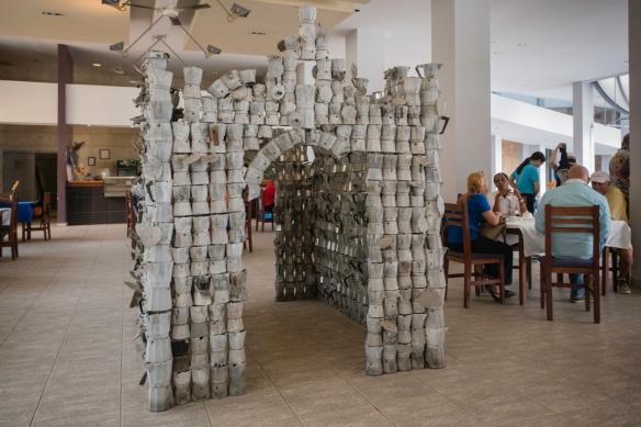 A contemporary sculpture (that visitors can walk trough) constructed out of metal espresso pots at the entrance to the museum_s café, Museo Nacional de Bellas Artes, Havana, Cuba