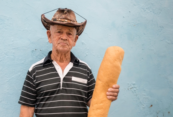 A local resident walking home with his fresh loaf of bread, Trinidad, Cuba