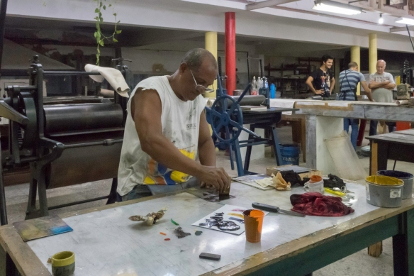 A printmaker at Taller Experimental de Gráfica, located at the end of a short cul-de-sac by the Cathedral in Havana, Cuba