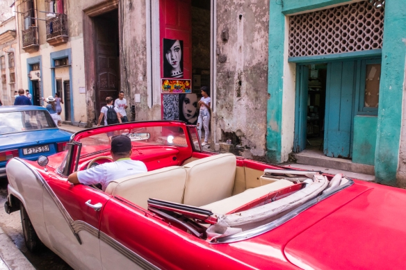 A privately owned and operated classic car that had been restored, Havana, Cuba – seen parked in Old Havana
