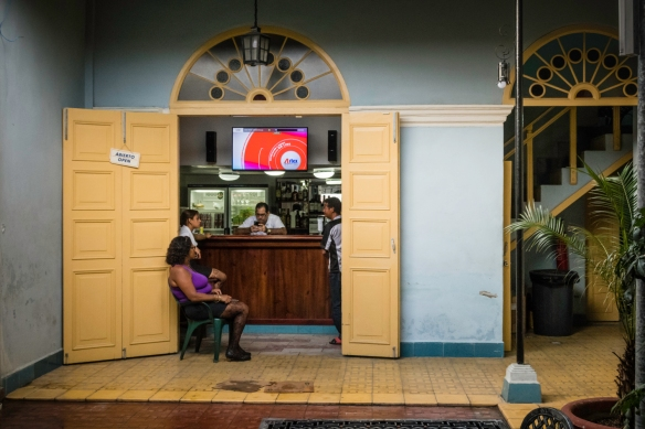 A quiet moment late in the afternoon in a bar near Parque José Martí in the Central Zone of Cienfuegos, Cuba