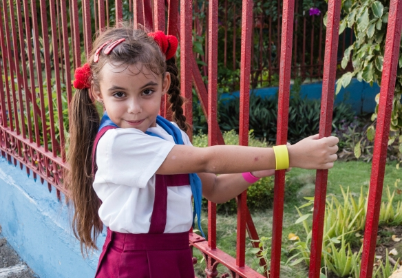 A school girl posed for your photographer as she began her walk home, Santiago de Cuba, Cuba