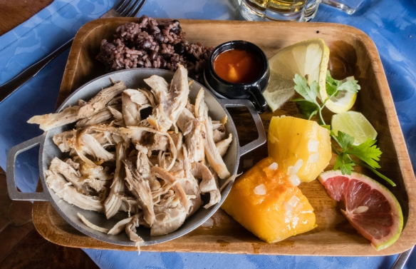 A second (and outstanding) main dish was sliced pork from a whole barbequed pork leg with the traditional side dishes, luncheon at El Lagarto, Cienfuegos, Cuba; for dessert we enjoyed a