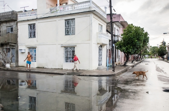 Daily constitutionals late in the afternoon after a pretty heavy rainstorm in a residential neighborhood near Parque José Martí in the Central Zone of Cienfuegos, Cuba