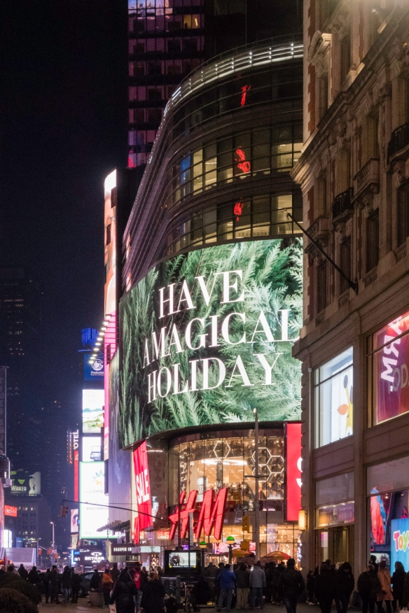 "It_s not just at Christmastime that Times Square is brightly lit, but the sign in the image gets into the year-end spirit- ""Have a Magical Holiday"", New York, New York, USA"