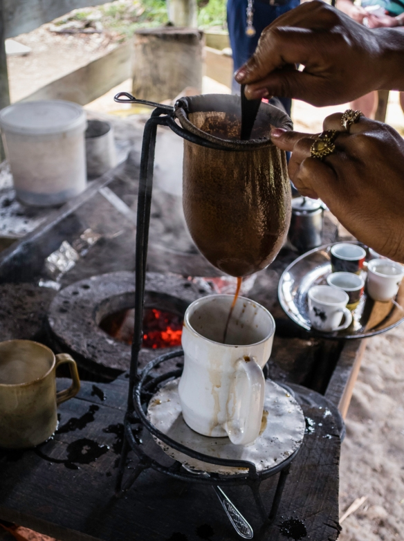 Locally grown and roasted coffee beans making a cup of drip coffee at a roadside stand on the summit of the Gran Parque Nacional Sierra Maestra, Santiago de Cuba, Cuba