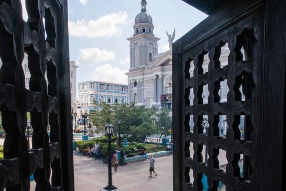 Nuestra Señora de la Asunción Cathedral (The Basilica Cathedral of Our Lady of the Assumption) and Parque Céspedes viewed from inside the Museo de Ambiente Histórico Cubano (loca