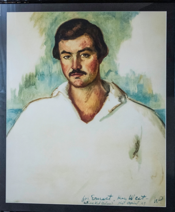 Oil painting portrait of Ernest Hemingway on the side wall of his bedroom occupied in 1939 in the Hotel Ambos Mundos in Havana, Cuba