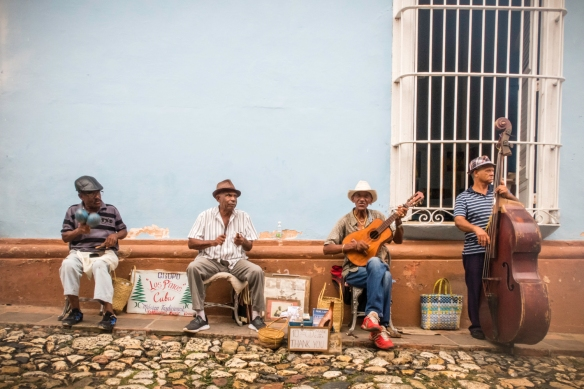 "On the streets, the first group we encountered was ""Los Pimos"", playing traditional Cuban music, Trinidad, Cuba; like music groups around the world, they were selling their CDs, in a"