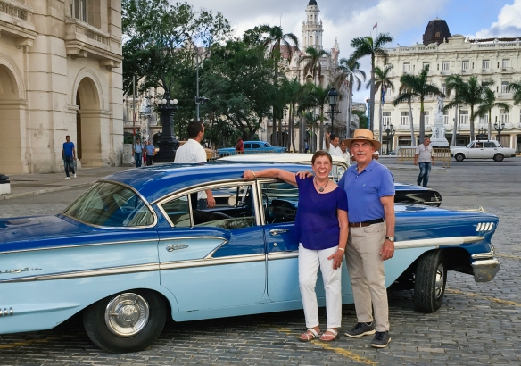 The intrepid explorer and your blogger outside the Grand Hotel Manzana Kempinski in the heart of Old Havana, Cuba, about to enter Nostalgicar Cuba_s blue 1957 Chevrolet Bel Air for a t