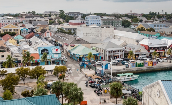 The road from the pier is an extension of East Street in Nassau, Bahamas; many restaurants, bars and cafes line Woodes Roger_s Walk (the street in the foreground), while, a block behin