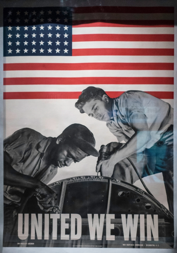 While the message conveyed in this 1942 propaganda poster is that racial unity is necessary for victory, African American workers often experienced discrimination and inequality, The Nat