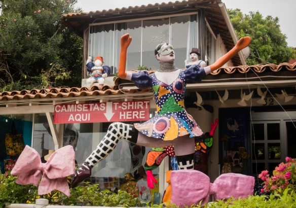 A colorful mannequin invites visitors into a local boutique, Búzios, Brazil