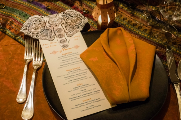 A place setting with elephant-design menu, Indian Dinner for Friends, on board our ship mid-Atlantic Ocean