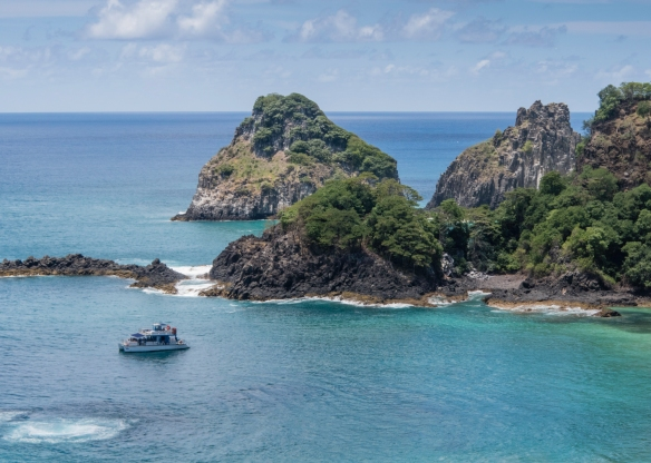 A tour boat in the bay off Praia do Sancho (Sancho Beach), Fernando de Noronha, Brazil