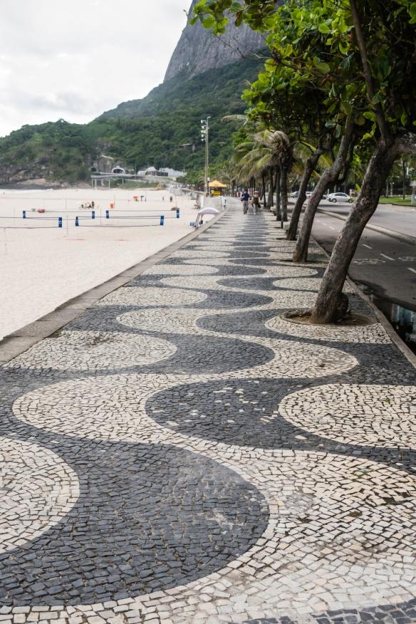 A typical Rio de Janeiro-Brazilian sidewalk mosaic design, along Praia da Joatinga (beach), São Conrado, Brazil