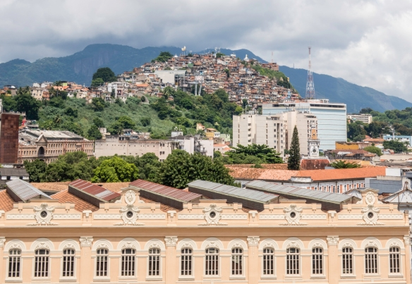 Across from the the waterfront at Pier Maua, on the hill, is a large favela, Brazilian Portuguese for slum -- a low-income, historically informal urban area in Brazil; Rio de Janeiro-8