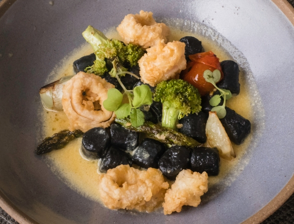An entrée (shared) of squid-ink gnocci with fried local calamari and vegetables in a delicious seafood sauce, Mistico, Búzios, Brazil