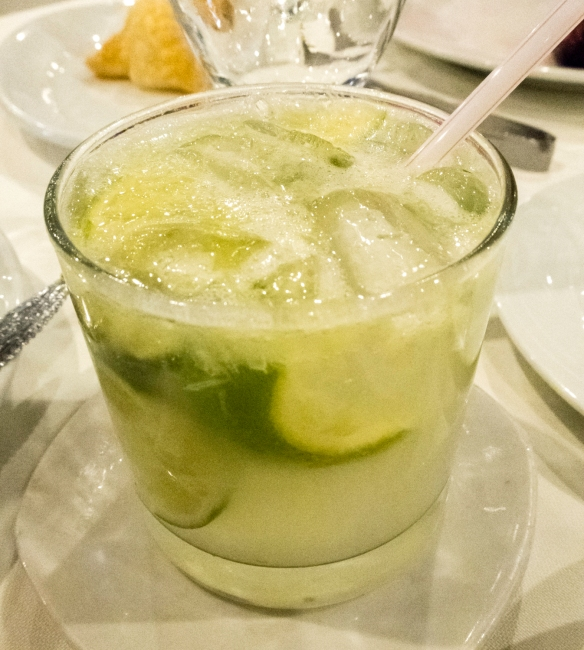 As we started our luncheon, our drinks arrived – shown here is a local favorite (Brazil_s national cocktail), a caipirinha – traditionally mixed with lime, and now made with a whol