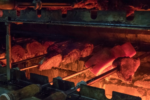 Close-up of meat on skewers on the churrasqueira (barbecue grill) at the Oasis restaurant, São Conrado, Brazil