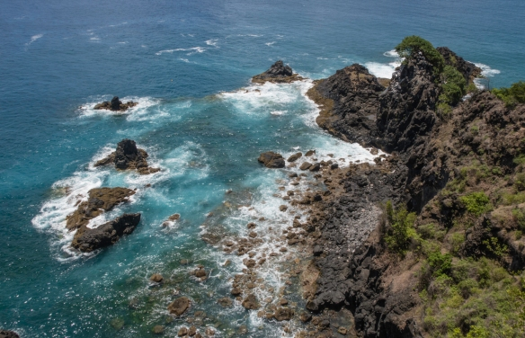 Coastal rock formations give evidence of the island_s volcanic origins, Fernando de Noronha, Brazil