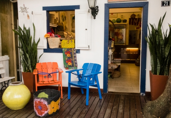 Colorful wares for sale outside and inside a boutique in the heart of Búzios, Brazil