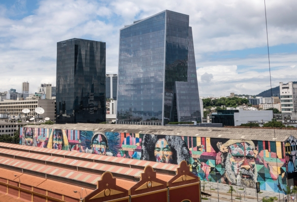 """Etnias"", the largest graffiti mural in the world and a legacy of the 2016 Rio, was painted by Brazilian graffiti artist Eduardo Kobra; it is the largest graffiti mural in the world and"
