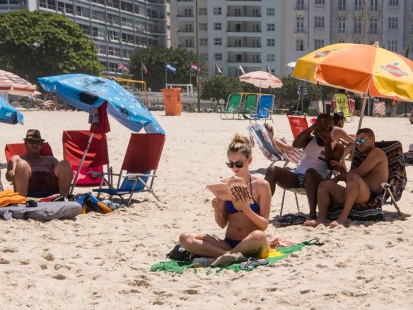 Relaxing on Copacabana Beach, Rio de Janeiro, Brazil