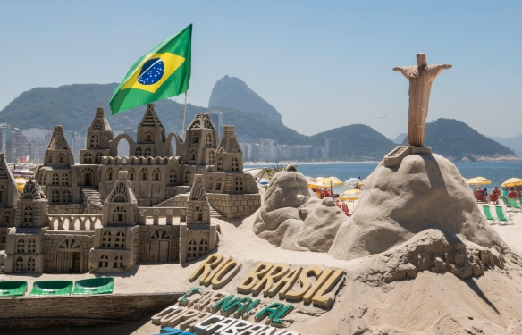 "Several master sand carvers have created mini sand ""masterpieces"" representing the local scenes, Copacabana Beach, Rio de Janeiro, Brazil"