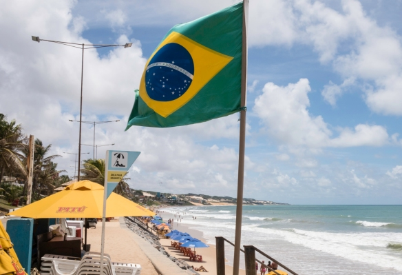 The Brazilian flag flying over Praia de Ponta Negra (Ponta Negra Beach), Natal, Brazil – a fitting last photograph from our time on this journey in Brazil