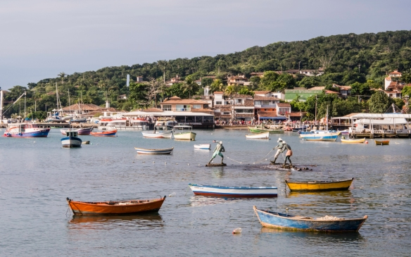 The statue of three fishermen in the harbor is very lifelike, Búzios, Brazil