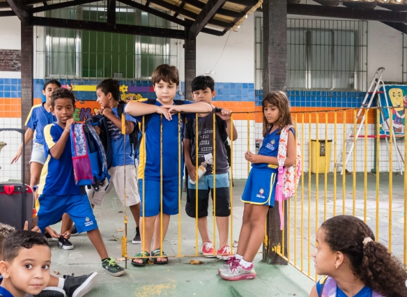 Young students at a local school (escola) in Barrio Passagem waiting for their parents to pick them up after school, Cabo Frio, Brazil