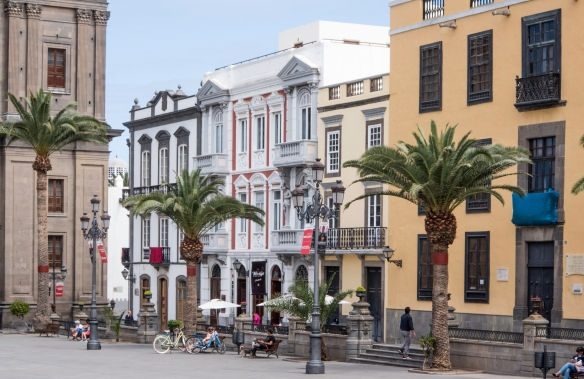 A close up of some of the buildings – now home to shops and restaurants on the ground floors -- on the plaza adjacent to Catedral de Santa Ana, Las Palmas de Gran Canaria, Canary Islan