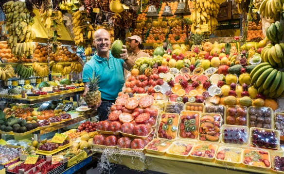 A very friendly vendor showing off some of his high quality fruits in his stall in the municipal food market, Mercado de Vegueta, Las Palmas de Gran Canaria, Canary Islands; we made some