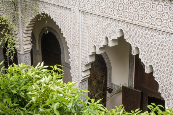 A view of the orange trees, arches and columns of the main patio-courtyard as seen from the upper level, Villa des Orangers, Marrakech, Morocco
