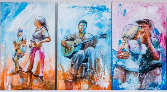 At the Cap Vert Design store – Design e Artesanato do Cabo Verde -- in Mindelo, São Vicente, Cape Verde (Cabo Verde) were a series of brightly colored paintings of musicians and danc