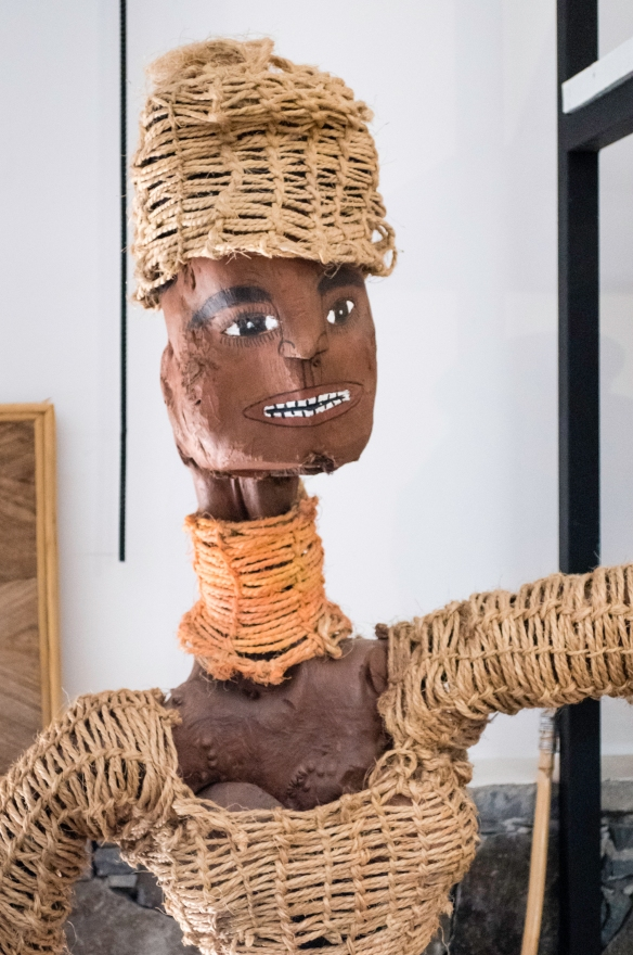 Cap Vert Design store, Mindelo, São Vicente, Cape Verde (Cabo Verde) – a ceramic figurine wearing woven clothes and cap