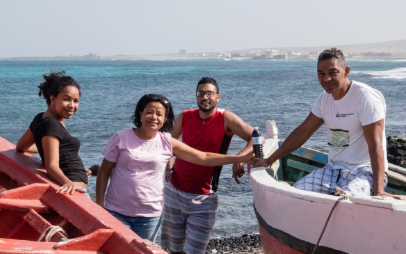 Locals enjoying lunch along the shore at the fishing boats, São Vicente, Cape Verde (Cabo Verde)