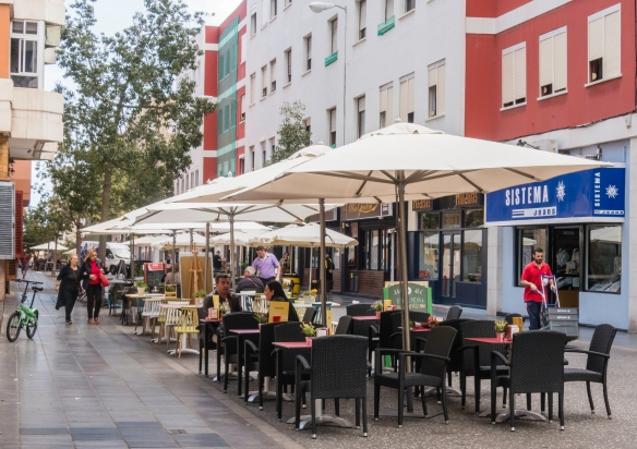Many restaurants and cafes in downtown Las Palmas de Gran Canaria, Canary Islands, have tables with sun umbrellas outdoors (in pedestrian zones)