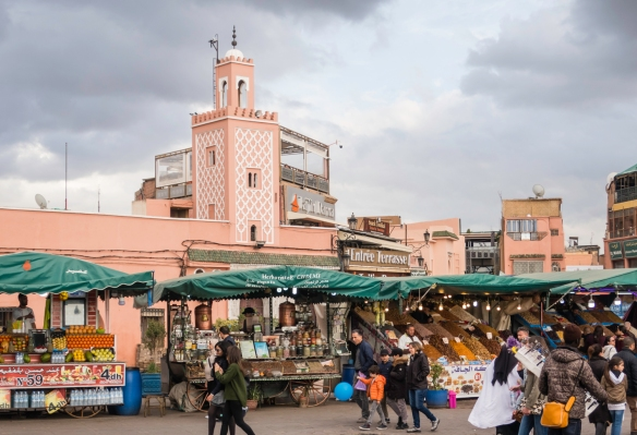 On one side of Jemaa el-Fnaa square are hotels and gardens and cafe terraces, and narrow streets that lead into the alleys of the medina quarter, Marrakech, Morocco