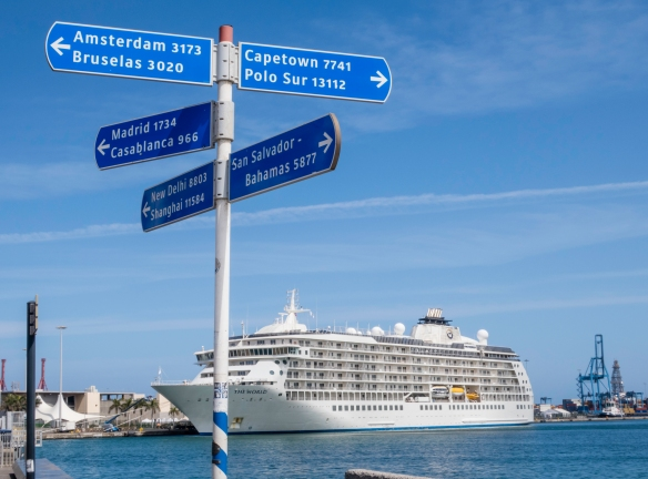 Our ship at the pier in Muella Santa Catarina, Las Palmas de Gran Canaria, Canary Islands, with a signpost (in meters) showing distances to far away ports_