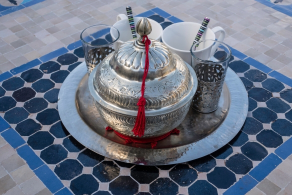 Tea service on the verandah at Kasbah Tamadot overlooking one of the Berber villages of Asni, High Atlas Mountains, Morocco