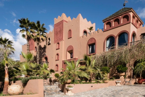 """The front façade and entrance of Kasbah Tamadot, a """"magical place perfect for rest and relaxation"""" located south of Asni in the High Atlas Mountains, Morocco"""