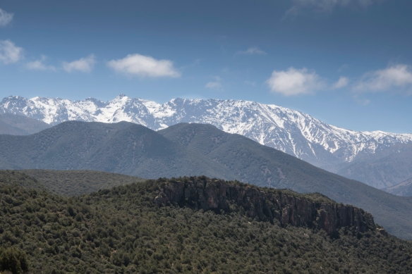The highest peak in Toubkal National Park is snowcapped Jebel Toubkal (4,167 meters-13,671 feet) – [upper center, left] -- High Atlas Mountains, Morocco