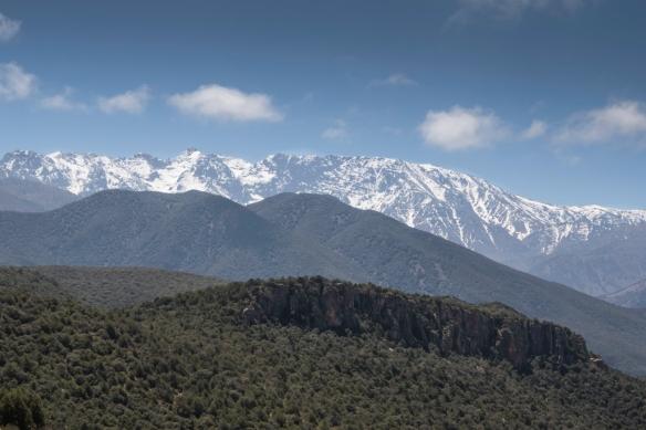 The highest peak in Toubkal National Park is snowcapped Jebel Toubkal (4,167 meters-13,671 feet) – [upper center, left] -- High Atlas Mountains, Morocco