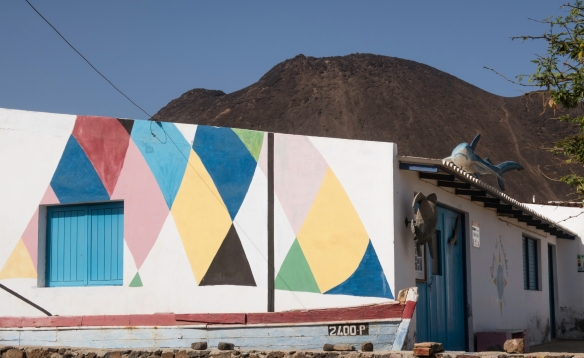 The highly decorated exterior of a fish restaurant at a small fishing village –note the turtle and shark sculptures -- on São Vicente, Cape Verde (Cabo Verde)