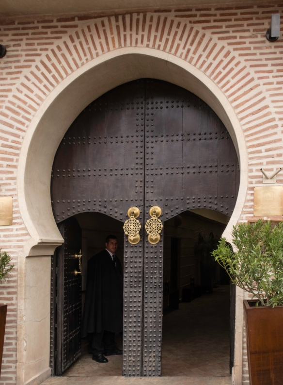The narrow arched street entrance to Villa des Orangers, Marrakech, Morocco, does not convey the size or architectural elegance of the riad (a traditional Moroccan medina house) where we