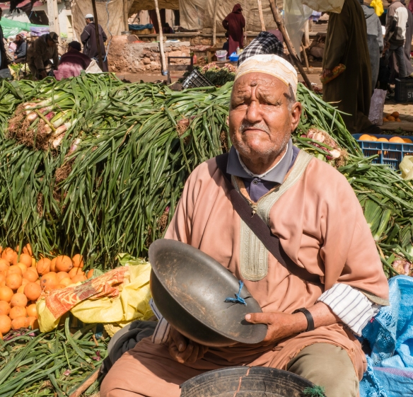 This fruit and vegetable vendor was disappointed that we weren_t in the market for any of his goods, Weekly Berber Market in Asni, High Atlas Mountains, Morocco